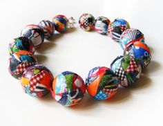 textile on plastic balls (upcycled- plastic balls from antiperspirants) crafts