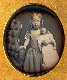 Rare c.1850 hand tinted daguerreotype photo, a chile with her wax doll