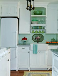 Perfect cottage kitchen with the jade dishes and tole painted tray. <3