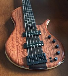 A Platinum Series single-cut 5 with a wenge neck? Yes, that's a thing!! And NO, it doesn't sound like a Warwick... This bass features a bees-wing bubinga top and Aero dual coil pickups. While it's no longer available, another wenge neck single-cut 5 will be returning to my inventory soon. Keep your eyes here for updates. #teamelrick #wefinance #actualhandmadebassguitars #nocncherebecausehandcrafted #noreally #happinessisanewbass #youknowyouwantit #elrickbasses #elrickbass #elrick #handc...