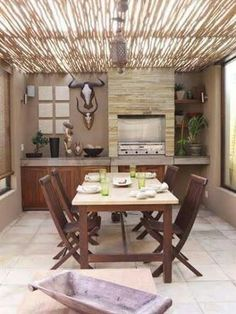 This sophisticated braai area has a cool, contemporary look with travertine flooring. to soften the clean lines, a rustic dark wood pergola was added to Outdoor Areas, Outdoor Dining, Dining Area, Indoor Outdoor, Dining Table, Outdoor Decor, Built In Braai, Wood Pergola, Outdoor Retreat