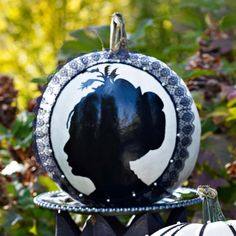 Create a classic, spooky look by spray painting silhouettes onto white-painted pumpkins: http://www.bhg.com/halloween/pumpkin-decorating/painted-pumpkin-ideas/?socsrc=bhgpin101314bestfaceforward&page=7