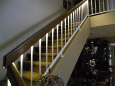 LEDs underneath the railing by Inspired LED #LED #Lighting #stairs #staircase #railing #accent
