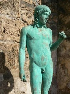 Pompeii, House of the Citharist. The copy of the statue of Apollo Citharoedus, after which the house was named, can be found in the lower peristyle while the original can be seen in the NAMN - AD 79