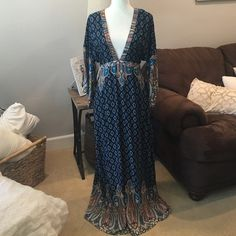 Gorgeous deep V neck Navy maxi dress size Medium Brand new never been worn Absolutely gorgeous maxi dress size medium. Deep V neck in the front and open back, also has a zipper for a better fit. Navy blue with teal, coral, beige/olive and rust color design. Beautiful dress!!! Dresses Maxi