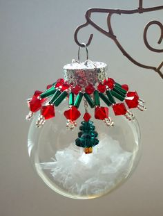 Christmas tree inside ornament (Cute idea would do something smaller on top) Holiday Crafts For Kids, Christmas Projects, Christmas Crafts, Christmas Ideas, Beaded Ornament Covers, Beaded Ornaments, Homemade Ornaments, Homemade Christmas Gifts, Crochet Christmas Ornaments