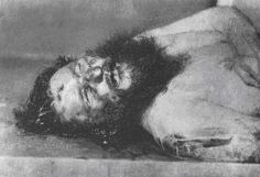 Post-mortem photograph of Rasputin showing the bullet wound in his forehead.