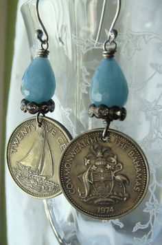 Gorgeous vintage 1974 Commonwealth of The Bahama Islands coins have been repurposed into dangle earrings, and I couldnt decide which side of the