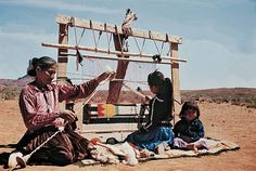 This is a photograph of women creating a textile weaving from the Navajo Native American tribe.  This image enables students to reflect on art created by every day people how their work is signifiant to their own culture and/or interests.