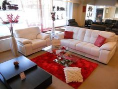 A Red & White living room for The Design Showcase, done by Tangent, Mumbai
