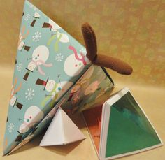"""Hexahedron origami """"box"""" closed! Big enough to hold 2 stuffed monkeys - tails hanging out..."""