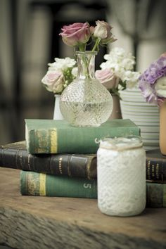 Vintage Wedding Decor.... your mom has lots of cute old books. They might make unique center pieces, on the cake/pie table with some fresh flowers, even in Mason jars.