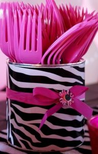 duct tape and tomato sauce can --- This is a great idea for plastic silverware - wont tip over like Solo cups!