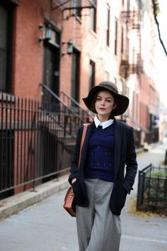 annie hall-esque:  floppy felt hat,   white collared shirt,    fitted blue sweater vest,  light wool blue blazer,    grey loose fit trousers,    small brown shoulder satchel bag ...   urban chic