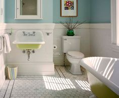 OMG! The chartreuse sink and tub and that hefty moulding on the floor and wainscot??? Yes, Please!