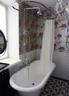 This is very cute - nice, traditional, practical   Roll top bath, shower, bathroom