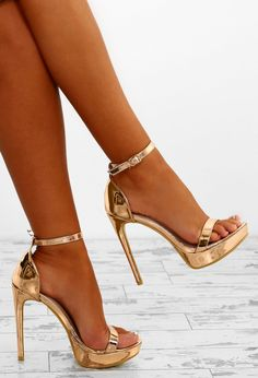 Up your shoe game for your next night out with these unreal rose gold platform heels! These rose gold heels are in a metallic sheen with buckle fastening at the ankle and a platform sole. Team these barely there stilettos with a sparkly mini dress and clu Red Stiletto Heels, Rose Gold Heels, Gold High Heels, Womens High Heels, Sparkly Gold Heels, Rose Gold Platform Heels, Sparkly Mini Dress, Black Heels, Stiletto Heels