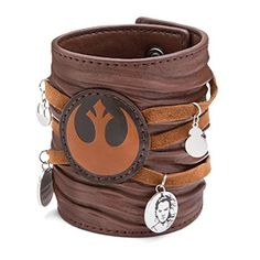Fortunately, you don't have to scavenge the deserts of Jakku for this Star Wars Ep 7 Rey Leather Cuff Bracelet, inspired by Rey's cuff. It closes with two riveted snaps and has little silver-colored dangle charms scattered across it.