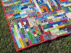 Scrappy Strip Quilt. I absolutely adore this quilt.