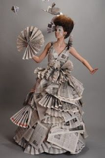 Portrait Of A Beautiful Girl In A Newspaper Dress Stock Photo, Picture And Royalty Free Image. Paper Fashion, Fashion Art, Fashion Show, Fashion Design, Fashion Textiles, Fashion Check, Recycled Costumes, Recycled Dress, Origami Vestidos