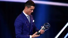 Real Madrid and Portugal's forward Cristiano Ronaldo holds his trophy after winning the The Best FIFA Men's Player of 2016 Award during The Best FIFA Football Awards ceremony, on January 9, 2017 in…