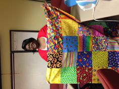 Ann Hightower is learning to sew as staff making mission quilts for the LWR 2013 Quilt Challenge.