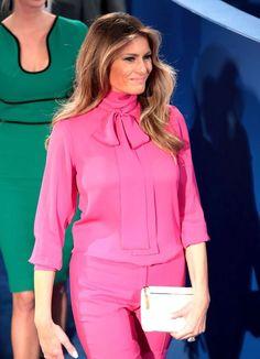 Melania Trump wearing a fuchsia Gucci shirt and matching pants October 2016
