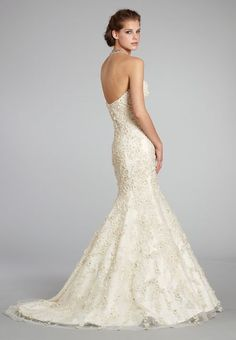 Stunning #Lazaro style #3254 wedding gown in ivory silk. More gorgeous in person with 3D chiffon fowler appliqués, crystals and seed pearls. This bridal gown just arrived on consignment ans she is Brans NEW.  Prices and size at LeDressBoutique.com