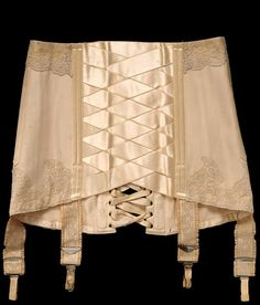 1914  Peach cotton, silk and lace corset, girdle styling with satin ribbon lattice down front and back lacing.  V Museum