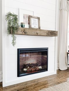 Add cozy ambiance to any room with this budget friendly DIY fireplace. For under… - Modern Home Fireplace, Fireplace Remodel, Living Room With Fireplace, Fireplace Design, Fireplace Mantels, Home Living Room, Fireplace Ideas, Shiplap Fireplace, Fireplace Makeovers