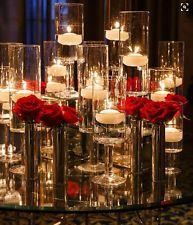 White floating candles are placed in tall glass stands and matched by metallic vases holding vibrant red roses. Like the idea but without red roses. Maybe white roses with glitter and red candles Reception Decorations, Wedding Centerpieces, Wedding Table, Table Decorations, Wedding Ideas, Wedding Venues, Wedding Mirror, Decor Wedding, Budget Wedding