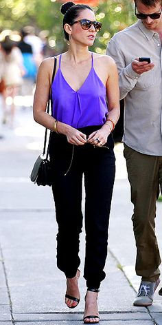 OLIVIA MUNN If youre going to wear harem pants in front of a guy, you better be pairing them with a damn sexy top. (Oh, and best to avoid the drop-crotch variety.) The actress counters the fashion-y-ness of her billowy A/X Armani Exchange bottoms with ankle-strap heels, a plunging purple tank and a chic MaxMara bag for a look thats surprisingly guy-hot.