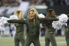 New York Jets cheerleaders perform during the first half of an NFL football game Thursday, Nov. 22, 2012 in East Rutherford, N.J. (AP Photo/Bill Kostroun)