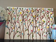 DIY artwork using canvas boards from Dollarama and acrylic paint. So easy for non-artists, and I like it because you can customize whatever colours you like.  Idea taken from: http://twogirlsbeingcrafty.blogspot.ca/2011/02/painted-wall-art-for-non-artists.html?m=1
