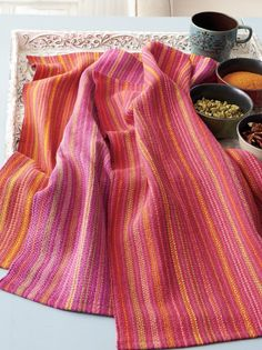 This summer, look to the textiles of India for your #weaving inspiration! Click here to see more and get the pattern for these summery striped towels. #summerweaving