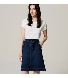"With a pretty waist tie and longer length, the forever-cool denim skirt gets a femme refresh. Zip fly. Waist tie. Belt loops. Front and back patch pockets. 22 1/2"" long."