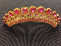 Antique-Georgian/Regency/Empire pinchbeck (gilt metal) comb tiara. The tiara has a triple row of deep rose/pink paste graduated stones.