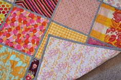 """Quilted with straight lines in gray thread.  Final size is about 42"""" square."""