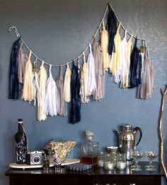 Paper Tassel Garland - I LOVE the colors in the garland.  It would be a great DIY project to attempt!