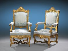 stately fauteuils feature grand Louis XIV and Louis XV ornamentation, from the central shell cresting and floral garlands on the high, indented backs to the bold scrolls, shells and acanthus decorations throughout. Cabriole legs and arms, a scrolling stretcher and luxurious upholstery complete these elaborate seats. Circa 1880