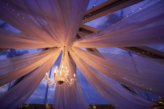 Bliss Maui Wedding - reception luxury lighting with twinkle lights and a chandelier