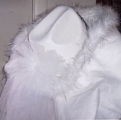 White felt fur trimmed brim light up tiaria cowgirl hat.  Comes with long or short mesh veil of your choice.  Sold by Doubletree Hotel and gottagottahaveit.com