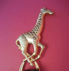 Hey, I found this really awesome Etsy listing at https://www.etsy.com/listing/66591653/giraffe-hang-em-up-lapel-pin-plus-gold