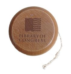 """This American made yo-yo is etched with """"Library of Congress"""" and its logo on one side, and Washington, D.C. on the other. Made of hard maple. 3 """" diameter."""