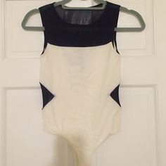 Body suit / Bebe / black and white / mesh Bebe small body suit with black mesh. Snaps at bottom. Brand new with tags, never worn. There is some discoloration right where it snaps underneath. bebe Other