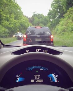 Standstill  #photogtaphy #driving #car #nissan #leaf #ev #electricvehicle #firstperson #fp #perspective #stopped #traffic #roadwork #blue #electric #green #jungle #cars #road #artsy #angled #focus by zack.alan.photography