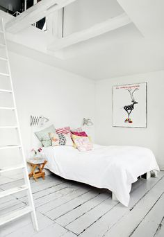 tiny bits of color in an otherwise all white room...so clean, yet somehow so feminine too