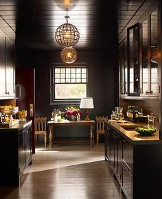 A dark and beautiful Butler's pantry by Steven Gambrel