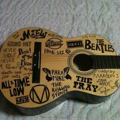 Awesome guitar with all of my favorite bands! But holy shit I would never wright on my guitar.