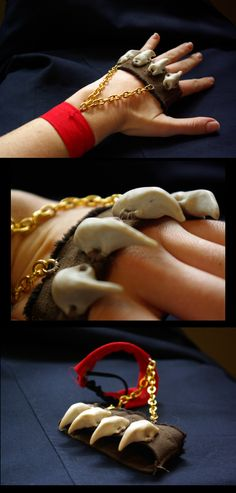 A set of knuckle claws made from Sculpey, leather, and fabric.